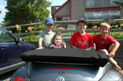 Children hang out in the convertible at a rental home